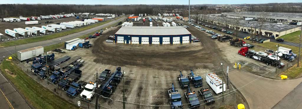 Elevated panoramic view of Eastland Towing's 20 acre secure fenced storage lot.
