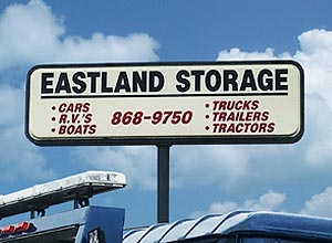 Sign above Eastland Towing's storage lot.